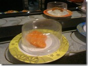 Salmon sashimi.. should we.. shouldn't we? We've had about four already.. one more won't hurt